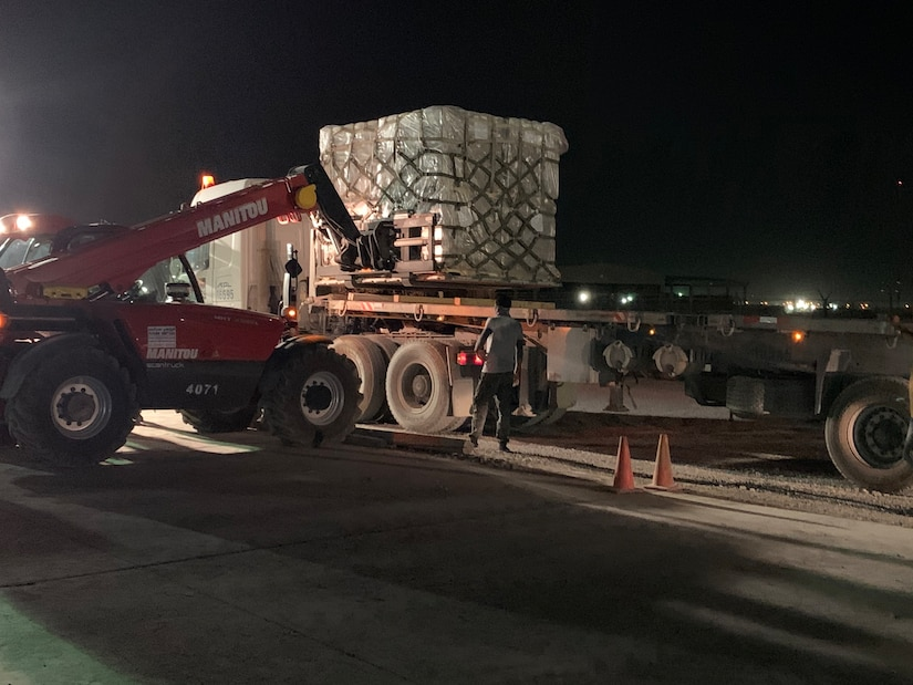 Personnel from the 1st Theater Sustainment Command executed night operations at Camp Arifjan, Kuwait, Aug. 5, 2020, in response to the Lebanon tragedy. 1st TSC Soldiers and contractors immediately responded to the crisis in Lebanon by packing supplies for transportation to a nearby flight line.