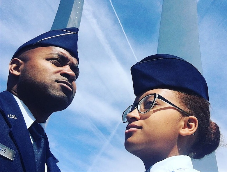 Maj. Kenneth Thomas, a navigator with the 94th Airlift Wing, Dobbins Air Reserve Base, Georgia, and his daughter, Dominica Thomas, a Civil Air Patrol cadet, pose for a photo at the Air Force Memorial in Washington D.C. in 2017.