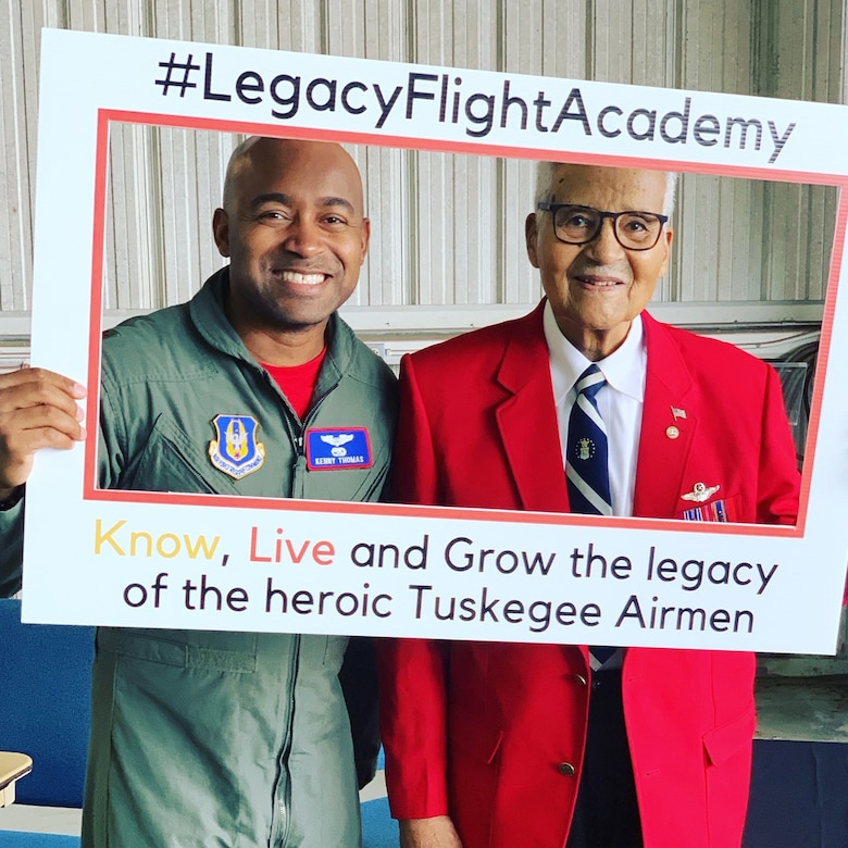 Brig. Gen. Charles McGee, an original Tuskegee Airmen, poses with Maj. Kenneth Thomas, a navigator with the 94th Airlift Wing, Dobbins Air Reserve Base, Georgia, at a Legacy Flight Academy event.