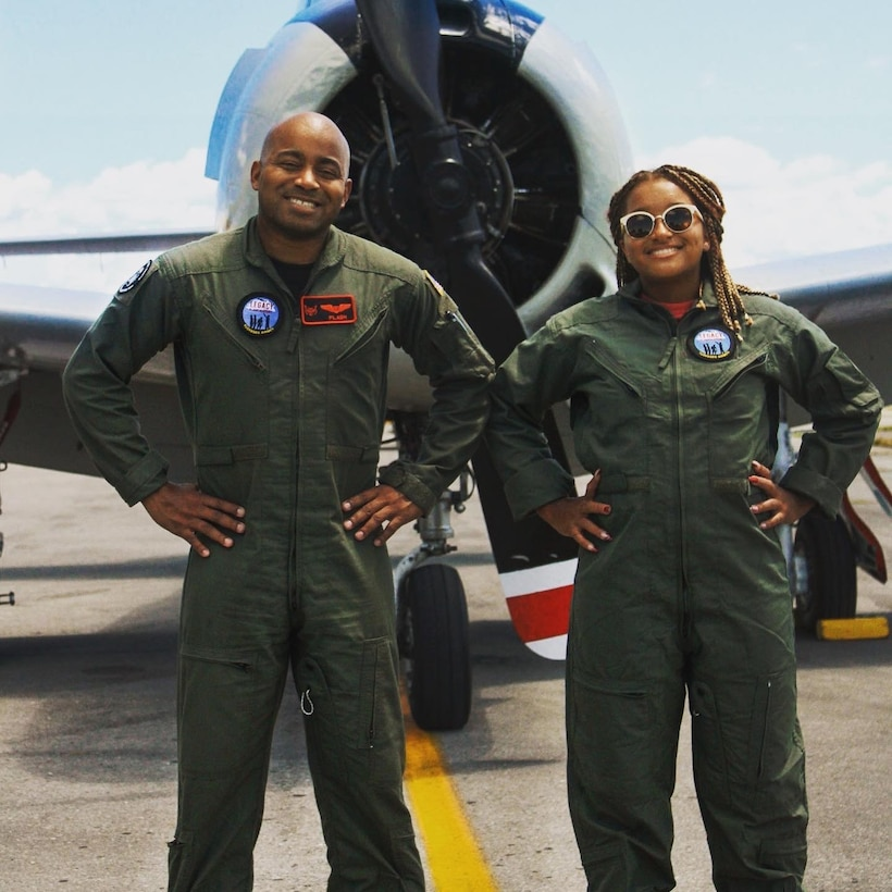 Maj. Kenneth Thomas, a navigator with the 94th Airlift Wing, Dobbins Air Reserve Base, Georgia, and his daughter, Dominica Thomas, after flying a historic T-28 Trojan Warbird in 2020.