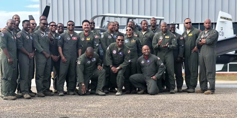 A group photo of a Legacy Flight Academy's Eyes Above the Horizon event at Moton Field in Tuskegee, Alabama in 2019.