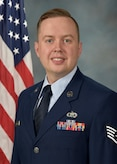 Official Photo of SSgt Jared Andrews, bassist with the Falconaires and Concert Band, two of nine ensembles in the United States Air Force Academy Band, Peterson AFB, CO.