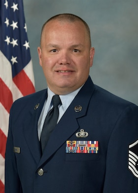 Official photo of MSgt Christopher Hammiel, trumpeter with the Falconaires and Concert Band, two of nine ensembles in the United States Air Force Academy Band, Peterson AFB, CO.