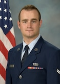 Official photo of A1C Dominic Sbrega, bassist with Wild Blue Country, one of nine ensembles in the United States Air Force Academy Band, Peterson AFB, CO.