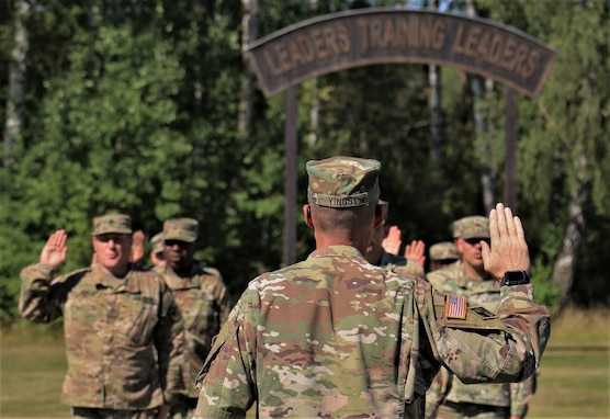 U.S. Army Reserve junior noncommissioned officers with the 7th Mission Support Command reaffirm their commitment to the NCO corps during a Junior Leader Certification Program ceremony held in Grafenwoehr, Germany, July 31, 2020. The program is designed to reinforce standards and is unique to the Army Reserve.