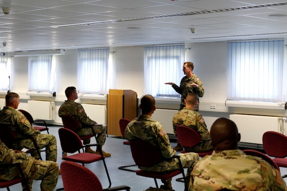 Command Sgt. Maj. Robert Abernethy, U.S. Army Europe command sergeant major, explains the importance of physical fitness to junior noncommissioned officers participating in a Junior Leader Certification Program during the 7th Mission Support Command's annual training at Grafenwoehr, Germany, July 29, 2020. The program is designed to reinforce standards and is unique to the Army Reserve.