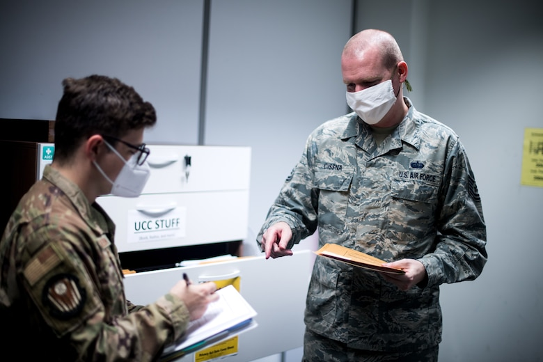 Photo of Airmen sorting through documents