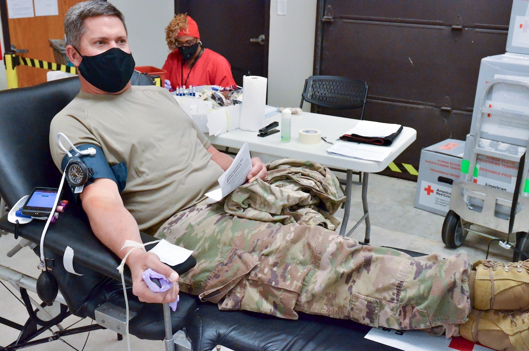 """Members of the 117th Air Refueling Wing participate in a blood drive on Aug. 14, 2020 at Sumpter Smith JNGB, Ala.  The donated blood went to local blood banks and will be used for conventional purposes like blood transfusions but extra vials of blood were taken to test for COVID-19 antibodies. Angelita Robinson, collection specialist II for the American Red Cross, explained that she's done thousands of blood drives in her 20 years with AMCROSS but testing for COVID-19 antibodies is a new step they have added. """"It's to check to see if a donor has the antibody,"""" Robinson said. """"If a donor recovered from the Coronavirus they would have antibodies still in their blood systems.""""  According to Robinson, having the antibodies in the bloodstream doesn't mean a person currently has COVID-19.  """"Any time a person has an illness or condition certain antibodies are built up in the blood,"""" she said. """"A person who does have the antibodies will be wanted to donate plasma so they can develop some kind of vaccine.""""  A donated unit of blood will be put in extra vials that go to a lab. Tests are conducted in labs using a plasma process for the antibodies which can be used in a vaccine. Even without testing of antibodies donated blood can help save a life. """"We still need blood for patients that are in the hospital like accident victims or people who need transfusions for surgeries,"""" Robinson said."""