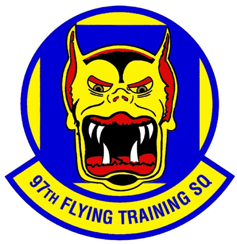 The 97 FTS emblem is the stylized face of a Devil Cat, trimmed in red and black with white tusks and green eyes on a blue background. The Devil Cat, neither cat nor wolf, has roamed the steppes of Asiatic Russia for generations. Its awesome appearance is but mildly indicative of the beast's true ferocity, of its almost diabolical wiliness and daring. In all of central and northern Asia, no animal real or legendary excites a greater respect or fear among the hardened and barbaric peoples of this vast hinterland. The Devil Cat portrays the endurance, courage, resourcefulness and ferocity, which the 97 FTS emulates.
