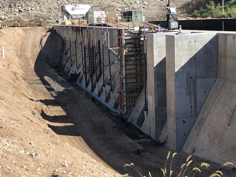 Work continues on improving stability and drainage around the stilling basin walls.  Here, workers construct concrete bases for post-tension anchors which will further secure the walls to the underlying bedrock.  Installation of the 34 anchors is the most technical and time consuming phase of the Stilling Basin Rehabilitation Project at Tuttle Creek Lake.