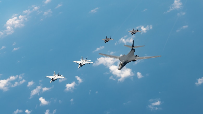 U.S. Navy Carrier Air Wing five F/A-18 Super Hornets, Marine Corps Marine Fighter Attack Squadron 121 F-35 Lightning IIs, all assigned to Marine Corps Air Station Iwakuni, Japan, and a U.S. Air Force 37th Bomb Squadron B-1B Lancer assigned to Ellsworth Air Force Base, S.D., conduct a large-scale joint and bilateral integration training exercise Aug. 18, 2020. Four B-1B Lancers, two B-2 Spirit Stealth Bombers, and four F-15C Eagles conducted Bomber Task Force missions simultaneously within the Indo-Pacific region over the course of 24 hours. Pacific Air Forces routinely conducts BTF operations to show the United States' commitment to allies and partners in the Indo-Pacific area of responsibility. (U.S. Air Force photo by Staff Sgt. Peter Reft)