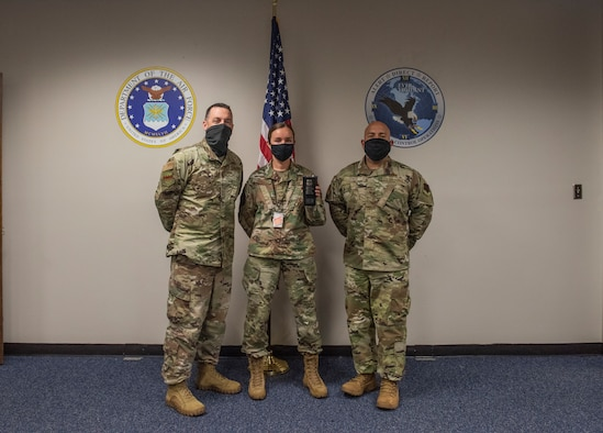 U.S. Air Force Col. Ryan Inman, 20th Fighter Wing (FW) vice commander, left, Staff Sgt. Amanda Gorbet, 20th Command Post emergency action controller, center, and Chief Master Sgt. Steve Cenov, 20th FW command chief, stand together for an award photo, at Shaw Air Force Base, South Carolina, Aug, 13, 2020.