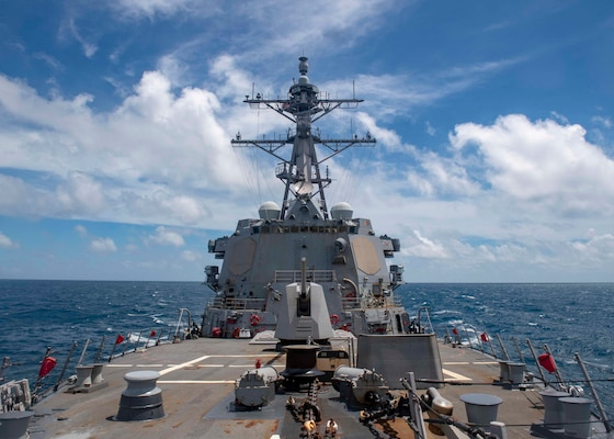The Arleigh Burke-class guided-missile destroyer USS Mustin (DDG 89) conducts routine operations in the East China Sea.