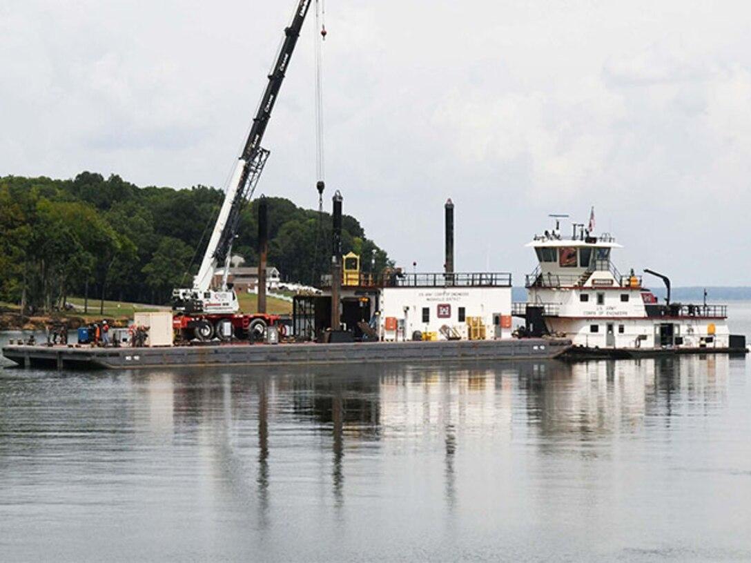 USACE barge transports debris screen at Wilson Lock