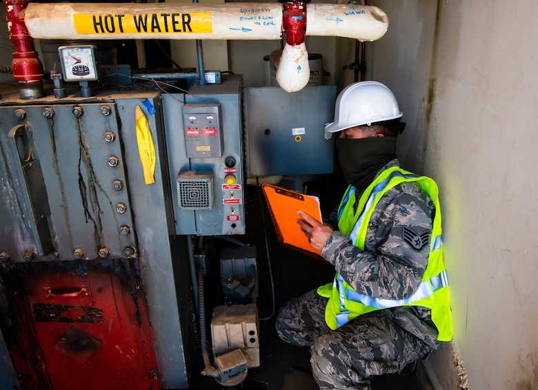 Staff Sgt. Kenny Chung, 56th Civil Engineer Squadron Operations Element heating, ventilation and air conditioning subject matter expert, inventories and inspects HVAC equipment Aug. 11, 2020, at Luke Air Force Base, Ariz.
