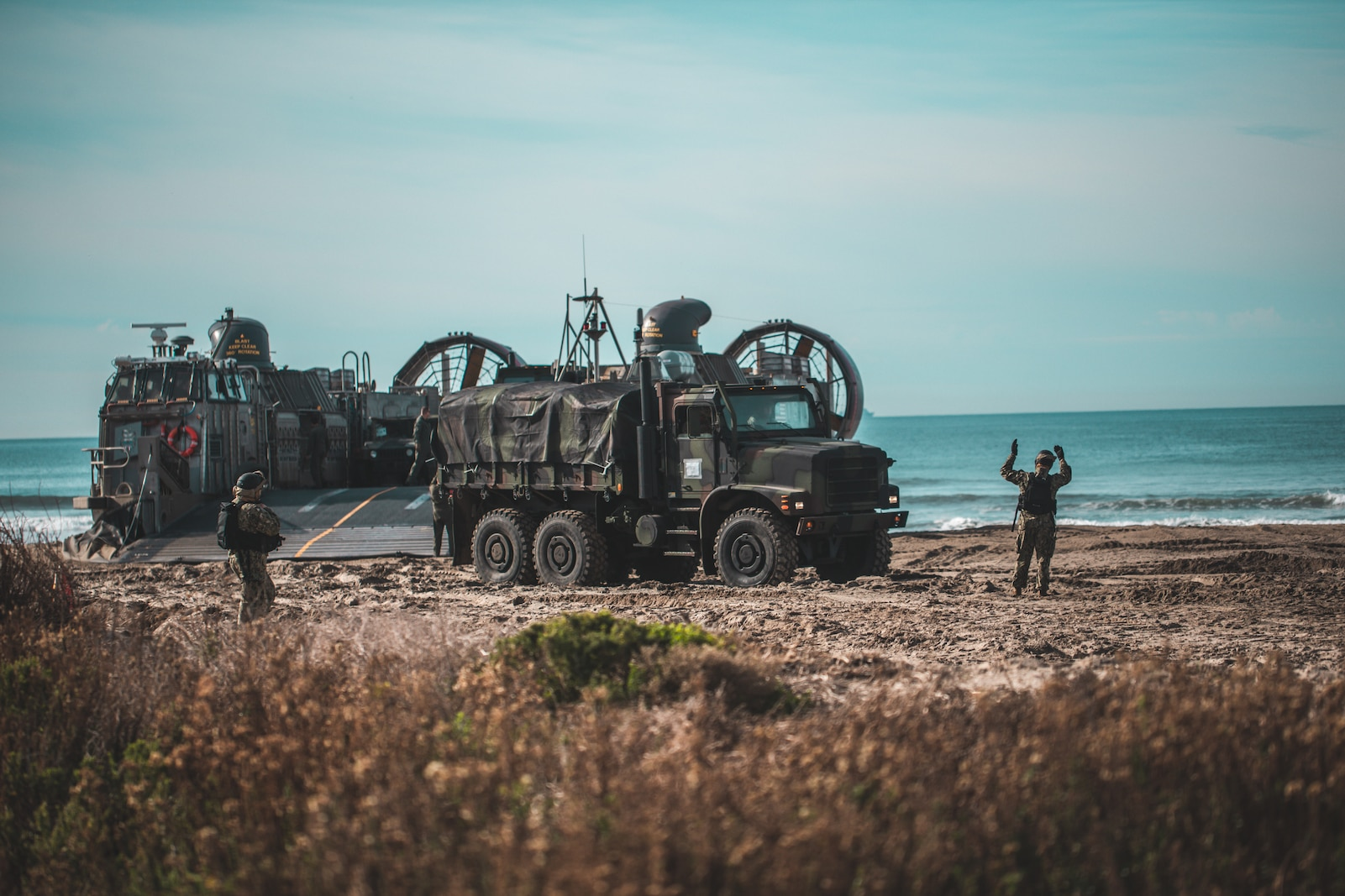 U.S. Marines with Combat Logistics Battalion 1, 1st Marine Logistics Group, offload a medium tactical vehicle replacement truck from a U.S. Navy landing craft air cushion during an amphibious assault while participating in Steel Knight 20 at Marine Corps Base Camp Pendleton, California on Dec. 6, 2019.