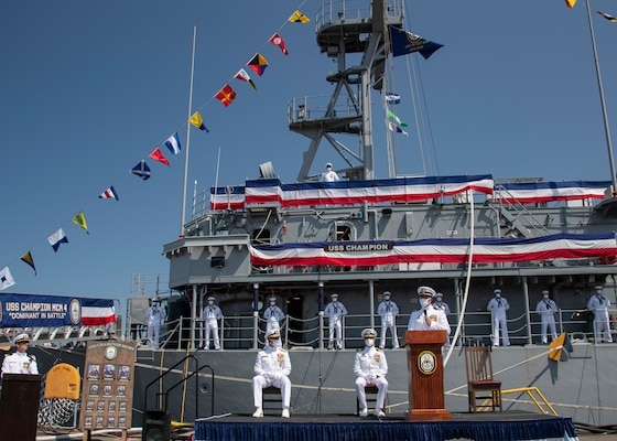 Lt. Cmdr. Matthew T. Yokely, commanding officer of the mine countermeasure ship USS Champion (MCM 4), delivers remarks during the decommissioning ceremony for Champion.