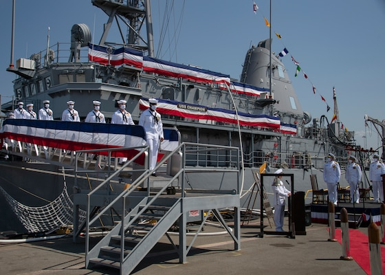 The crew of the mine countermeasure ship USS Champion (MCM 4) disembarks the ship for the final time during the decommissioning ceremony for Champion.