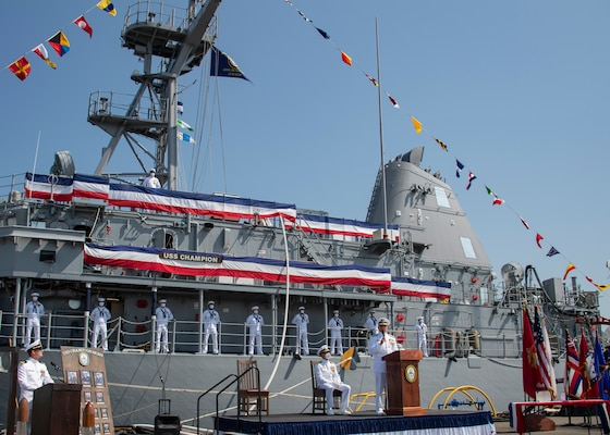 Rear Adm. Scott Robertson, commander of Naval Surface and Mine Warfighting Development Center, delivers remarks during the decommissioning ceremony for the Mine Countermeasure ship USS Champion (MCM 4).