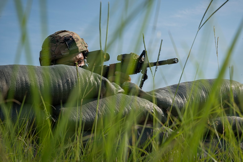 Photo of an Airman manning a defensive fighting position