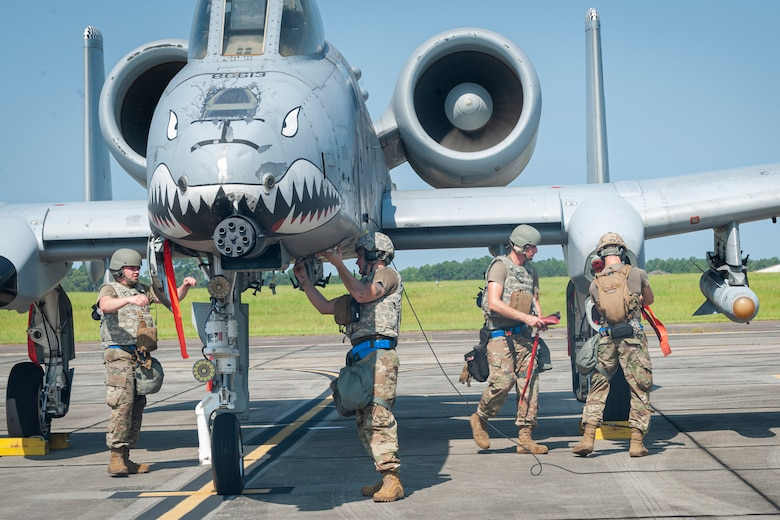Photo of Airmen preparing an A-10C Thunderbolt II for takeoff