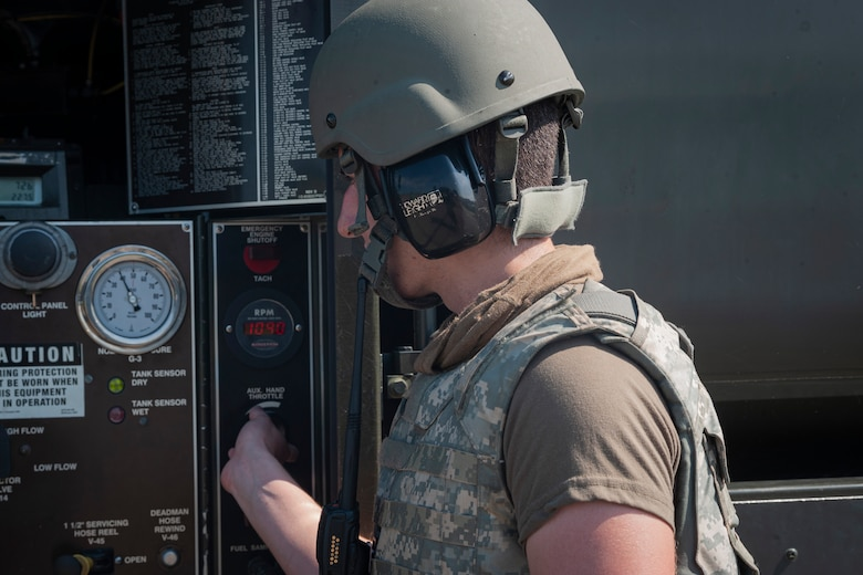 Photo of an Airman checking fuel gauges