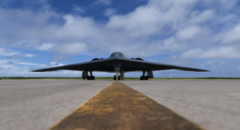 U.S. Air Force Senior Airman Robert Witkowski and Staff Sgt. Mark Farrar, 393rd Expeditionary Bomb Squadron crew chiefs, deployed from Whiteman Air Force Base, Missouri, prepare a B-2 Spirit Stealth Bomber for take-off at Naval Support Facility Diego Garcia, to support a Bomber Task Force mission,  Aug. 17, 2020. Bomber Task Force missions allow U.S. Strategic Command to provide persistent, long-term bomber presence in the Indo-Pacific, and around the globe. Over the course of 24 hours, four B-1B Lancers, two B-2 Spirit Stealth Bombers, and four F-15C Eagles conducted Bomber Task Force missions simultaneously within the Indo-Pacific region. Pacific Air Forces routinely conducts BTF operations to show the United States' commitment to allies and partners in the Indo-Pacific area of responsibility. (U.S. Air Force photo by Tech. Sgt. Heather Salazar)