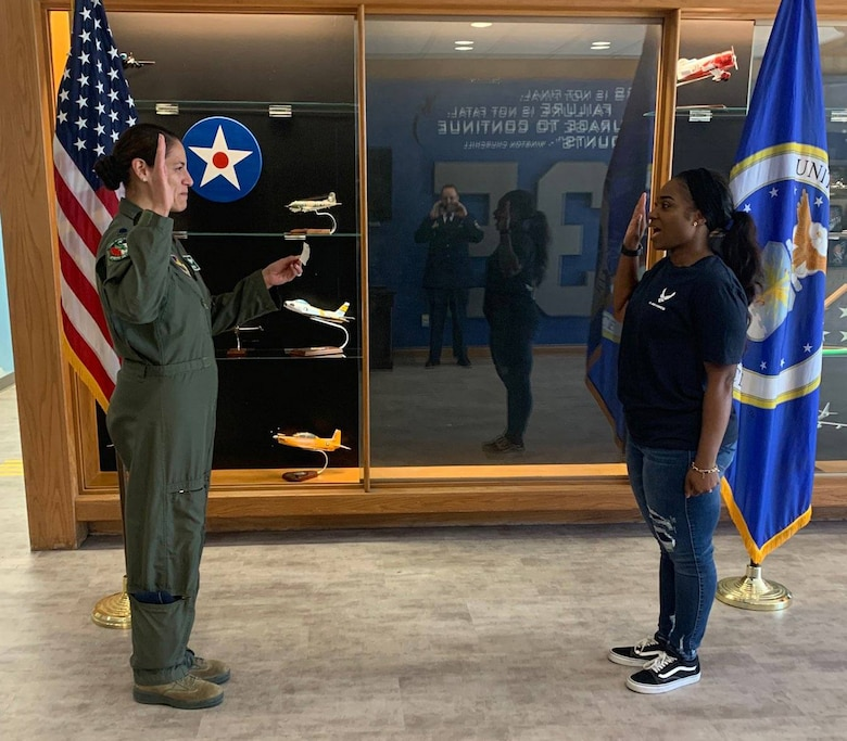 Staff Sgt. Ashley Edwards takes the oath of enlistment from Lt. Col. Sandra Bonney, who at the time was the Air Force ROTC commander at the University of North Texas.