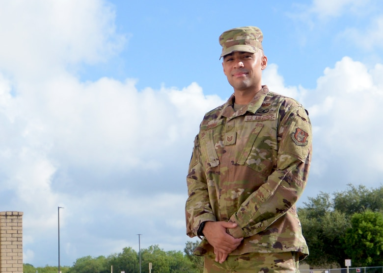 Tech. Sgt. Samuel Brown, 960th Cyberspace Operations Group client systems technician, stands for a photo outside the 960th Cyberspace Wing headquarters building Aug. 8, 2020, at Joint Base San Antonio-Chapman Training Annex, Texas. (U.S. Air Force photo by Samantha Mathison)