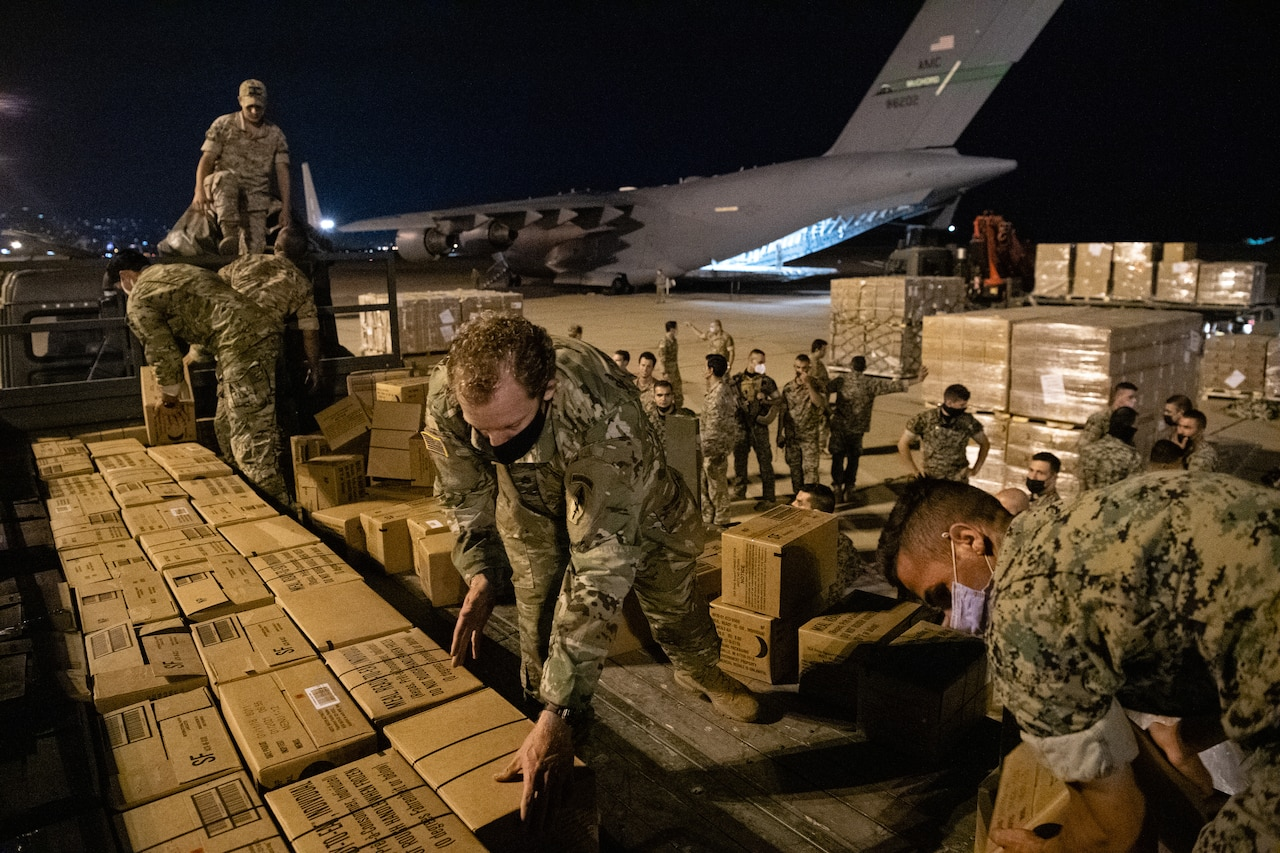 Airmen unload a C-17 at Beirut International Airport.