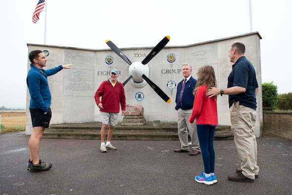 U.S. Army Capt. Chris Philhower (left), U.S. Africa Command Directorate for Intelligence at RAF Molesworth technician, speaks with David Crow (second from left), a local from Steeple Morden who helped build the memorial, during Operation TORCH-2020 memorial cleanup August 15, 2020. U.S. Africa Command Directorate for Intelligence at RAF Molesworth partnered with the American Battle Monuments Commission to host Operation TORCH-2020, where over 50 military members and their families, U.K. nationals and Boy Scout Troop #245, cleaned six WWII memorial sites to preserve American service member legacies and promote an appreciation of past American heroes among present-day USAFRICOM workforce and families. (U.S. Air Force Photo by Airman 1st Class Jennifer Zima)