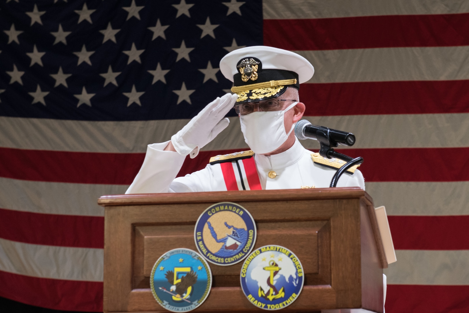 NAVAL SUPPORT ACTIVITY BAHRAIN (Aug. 19, 2020) Vice Adm. Jim Malloy, commander of U.S. Naval Forces Central Command (NAVCENT), U.S. 5th Fleet and Combined Maritime Forces (CMF) salutes as he is relieved of command by incoming commander Vice Adm. Sam Paparo during the hybrid change of command onboard Naval Support Activity Bahrain Aug. 19, 2020. NAVCENT is the U.S. Navy element of U.S. Central Command in the U.S. 5th Fleet area of operations and encompasses about 2.5 million square miles of water area and includes the Arabian Gulf, Gulf of Oman, Red Sea and parts of the Indian Ocean. The expanse is comprised of 20 countries and includes three critical choke points at the Strait of Hormuz, the Suez Canal and the Strait of Bab al Mandeb at the southern tip of Yemen. (U.S. Navy photo by Mass Communication Specialist 3rd Class Dawson Roth)