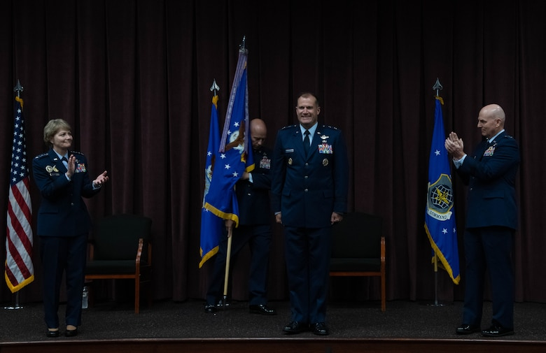 Maj. Gen. Bibb stands between Gen. Miller on the left and Maj. Gen Barrett on the right with Chief Simpson in the back holding the guidon