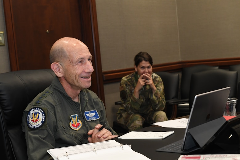 Gen. Mike Holmes, commander of Air Combat Command, smiles as he tells a story from when he was a young squadron commander during an outbrief for Sword Athena 2020 as part of a virtual Zoom call hosted by Air Combat Command Aug. 14, 2020 from Joint Base Langley-Eustis, Virginia. SA20 was a leadership symposium designed to develop rising leaders, across all enlisted and commissioned ranks, to focus on the female- and family-centric issues that impact readiness. (U.S. Air Force photo by Tech. Sgt. Nick Wilson)
