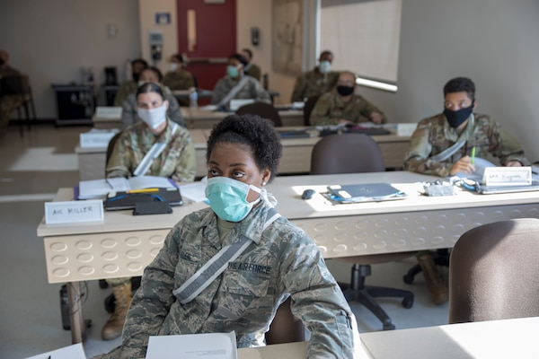 Military students in class wearing masks.
