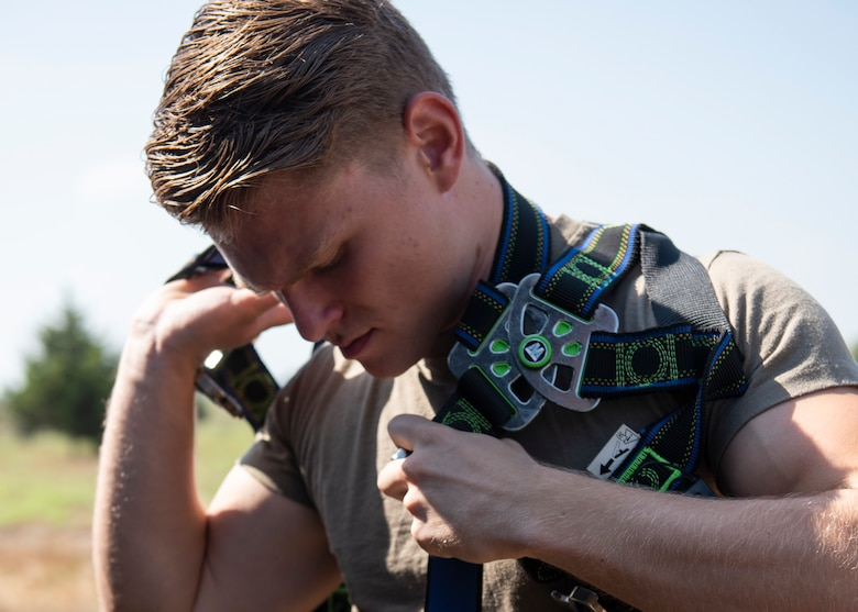 U.S. Senior Airmen Noah Dray puts on a safety harness at Incirlik Air Base, August 12, 2020.