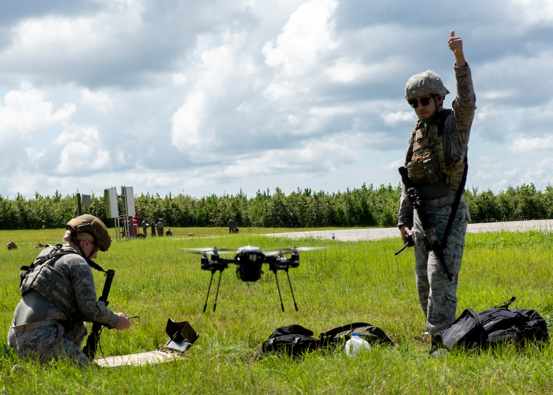 Airmen from Seymour Johnson Air Force Base deploy an Unmanned Aerial Vehicle during Joint Exercise Razor Talon at Cherry Point Marine Corp Air Station, North Carolina, Aug. 12, 2020.
