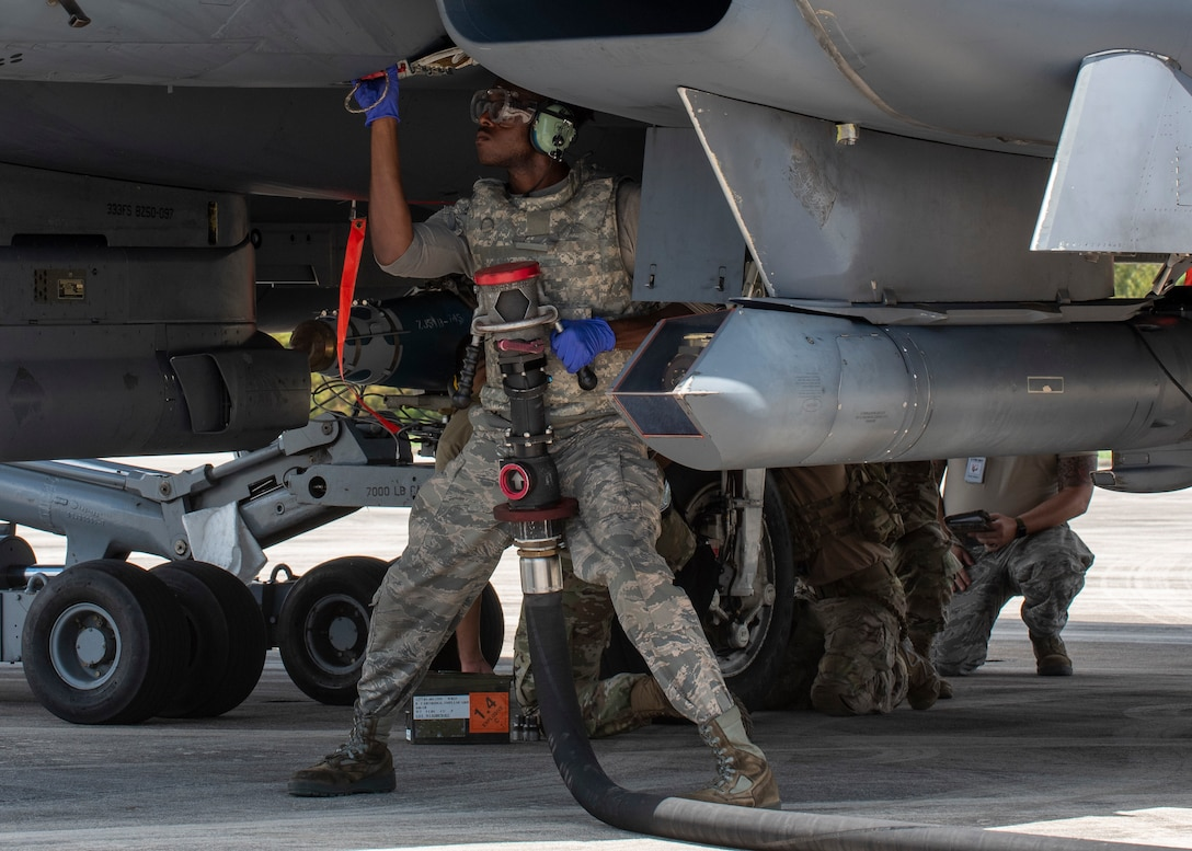 An Airman assigned to Seymour Johnson Air Force Base hot-pit refuels an F-15E Strike Eagle during Razor Talon at Cherry Point Marine Corp Air Station, North Carolina, Aug.12, 2020.