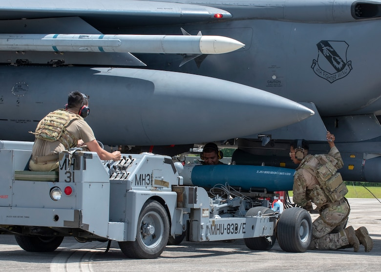 Airmen from Seymour Johnson Air Force Base load munitions onto an F-15E Strike Eagle during Razor Talon at Cherry Point Marine Corp Air Station, North Carolina, Aug.12, 2020.