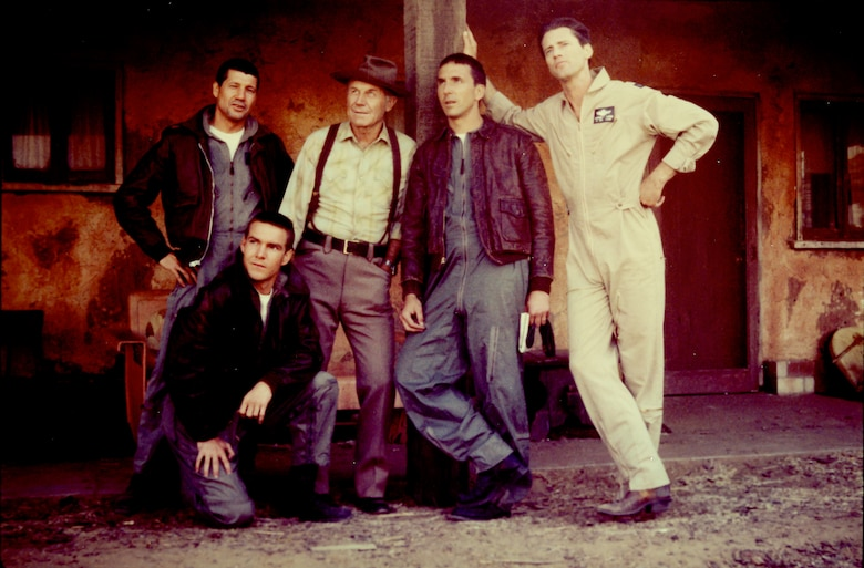 "Brig. Gen. (retired) Chuck Yeager poses for a photo with the cast of the film ""The Right Stuff"" at Edwards Air Force Base in 1982. Yeager played the bartender ""Fred"" during a cameo appearance in the film. (Photo courtesy of Air Force Test Center History Office)"