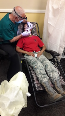 SMSgt. Eleanor Torres, 940th AMDS/SGO receives a dental check up during the August UTA weekend.