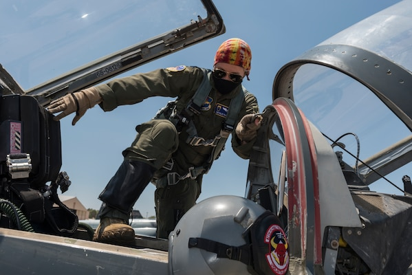 Captain Natalie Rambish, 47th Operations Support Squadron aircrew and flight equipment commander and instructor pilot, climbs into her seat in a T-38C Talon as she prepares to fly with a student pilot, Aug. 11, 2020 at Laughlin Air Force Base, Texas. She is a member of Laughlin's Female Aviators' Mentorship Group because she loves the camaraderie and the chance to find other women aviators who she can look up to. (U.S. Air Force photo by Senior Airman Anne McCready)
