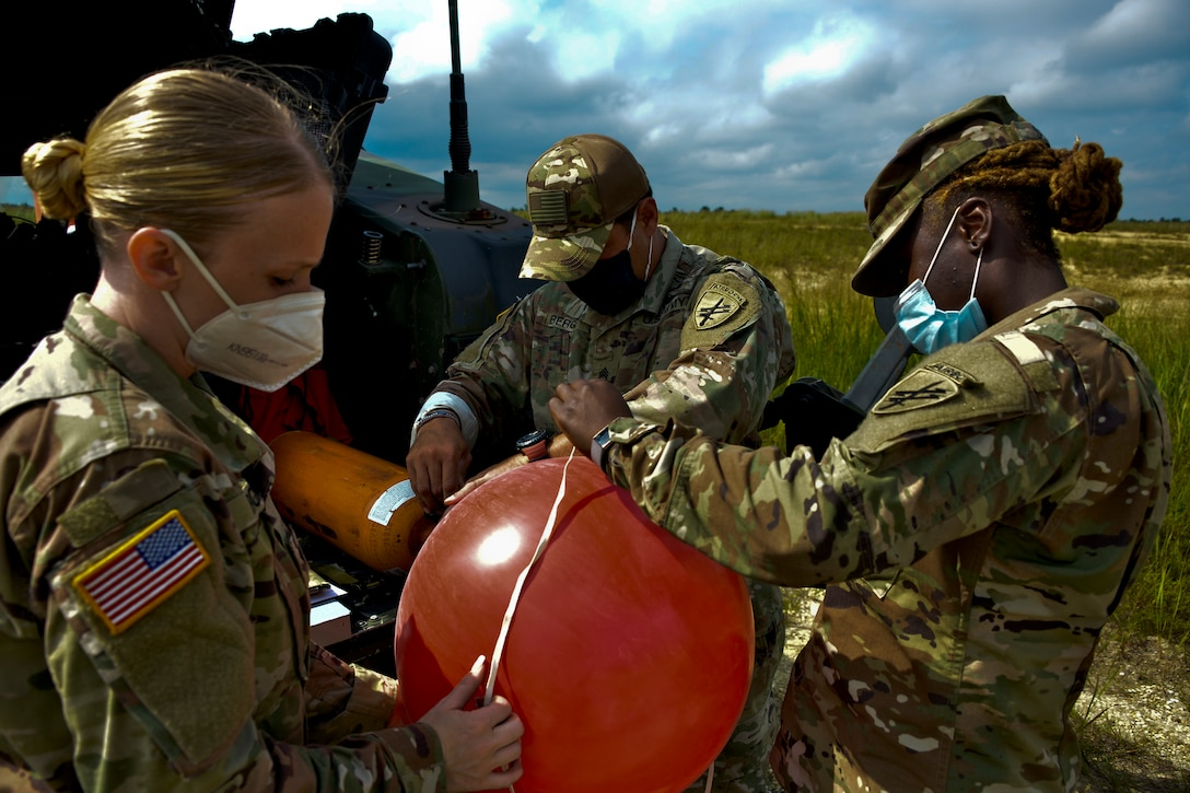 JOINT BASE MCGUIRE-DIX-LAKEHURST, N.J. – A drop zone detail with the U.S. Army's 404th Civil Affairs Battalion, United States Army Civil Affairs & Psychological Operations Command (Airborne), measure weather balloons in preparation for airborne operations here on Aug. 14, 2020. Soldiers assigned to drop zone support operations complete a list of tasks to include measuring wind knots and distance, which provide vital information to the execution of airborne operations.