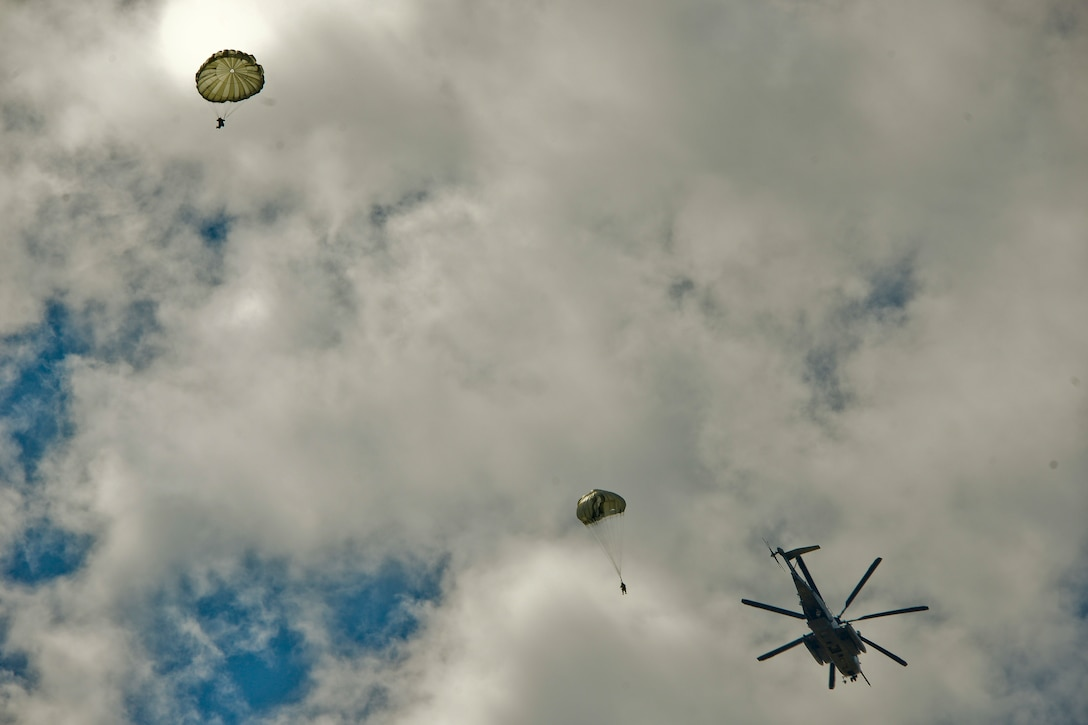 JOINT BASE MCGUIRE-DIX-LAKEHURST, N.J. – Paratroopers with 404th Civil Affairs Battalion, United States Civil Affairs & Psychological Operations Command (Airborne), jump out of a Sikorsky CH-53 Sea Stallion Helicopter during a large scale airborne operation here on Aug. 14, 2020. The unit conducted non-tactical airborne operations in order to maintain mission readiness and proficiency among their paratroopers.