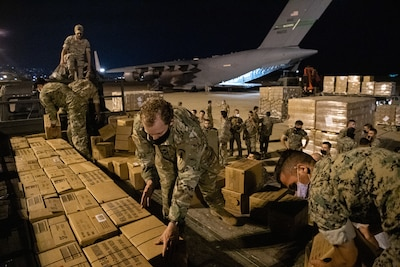 Lebanese and U.S. Armed Forces service members unload humanitarian aid supplies delivered by a U.S. Air Force C-17 Globemaster III at Beirut, Lebanon, Aug. 6, 2020. U.S. Central Command is continuing to coordinate with the Lebanese Armed Forces, the U.S. Embassy-Beirut and USAID to transport critical supplies as quickly as possible to support the needs of the Lebanese people. (U.S. Air Force photo by Staff Sgt. Justin Parsons)