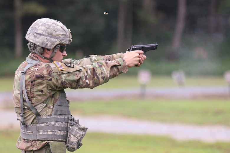 One of the more than 100 Pennsylvania National Guard Soldiers and Airmen who competed in the annual Governor's Twenty competition Aug. 14-15 at Fort Indiantown Gap, Pa., fires his pistol, one of the event's four matches. (U.S. Army National Guard photo by Sgt. Andrew Weston)