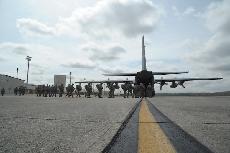 paratroopers prepare to load an aircraft