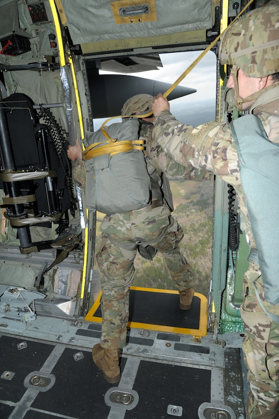 a soldier prepares to jump from an aircraft