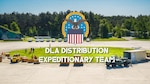 Vehicles, boxes and forklifts surround a circle of grass. The DLA logo with an eagle, stars and stripes is imposed over the image with the words: DLA Distribution Expeditionary Team.