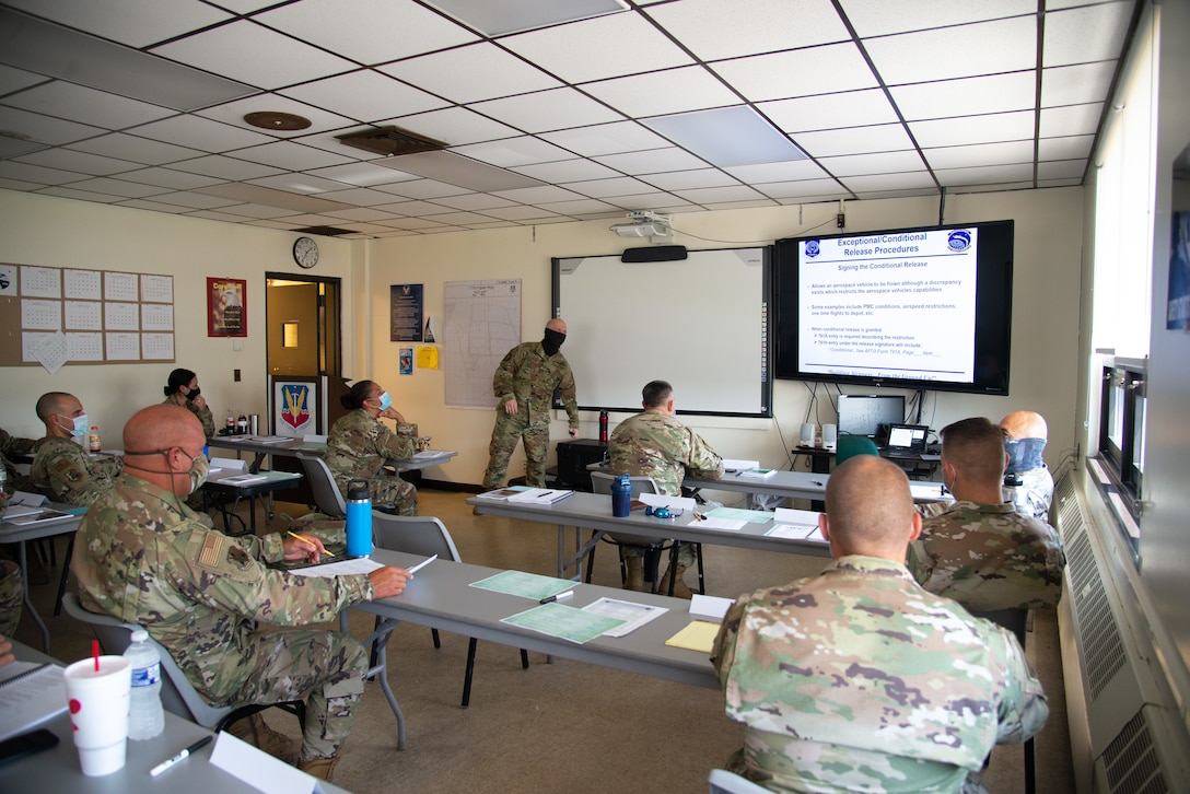 A photo of SMSgt. Dean L. Couch teaching 177th Aircraft Maintenance Squadron members.